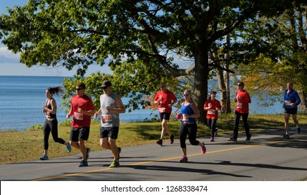 Runners in the Half marathon of the 14th Annual County Marathon Prince Edward County on Athol Bay, Lake Ontario in Sandbanks Provincial Park, Canada - September 30, 2017