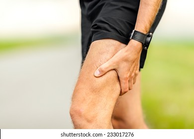 Runners leg and muscle pain on running training outdoors in summer nature, sport jogging physical injury when working out. Health and fitness concept with sore body