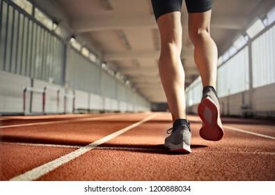 Runner's legs in motion.