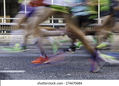 Runners Legs unfocused in marathon / Marathon