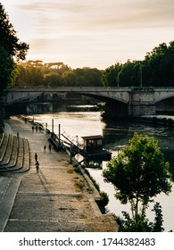 Runners on the Lungotevere along the Tiber river in Rome during COVID-19 lockdown