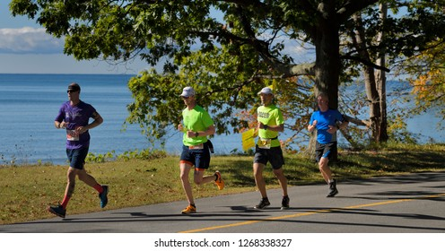 Runners and Pacer in the 14th Annual County Marathon Prince Edward County on Athol Bay, Lake Ontario, in Sandbanks Provincial Park, Canada - September 30, 2017