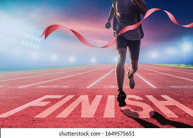 Runners running towards the finish line. Success concept.