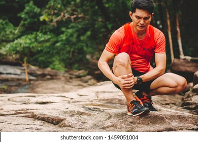 Runners. Young people  trail running on a mountain path. Adventure trail running on a mountain. Runners receive injuries from running trails on a mountain