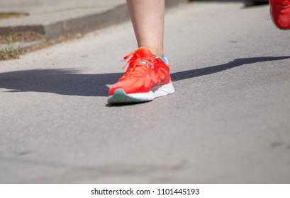 runnes feet back race on asphalt action , background