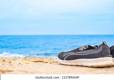 Runnig shoes on beach side that feel fresh environment to work out. Very good place for relaxing.