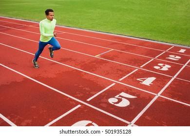 Running african man at stadium