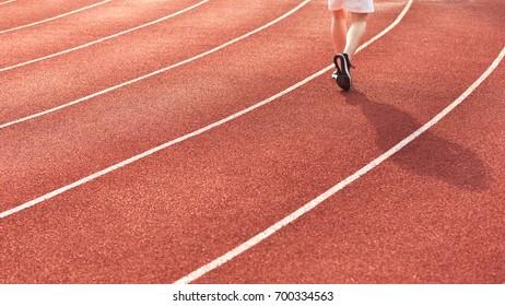 Running Alone Around an Athletics Track in Stadium