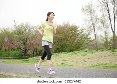 running Asian woman