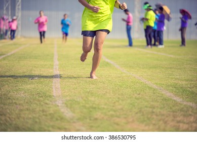 Running athletes at stadium in race athletics competition
