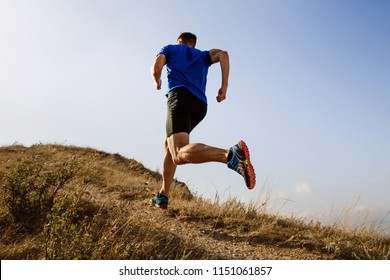 running autumn trail on male athlete runner