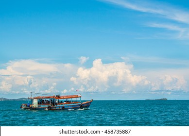 Running boat in big blue sky