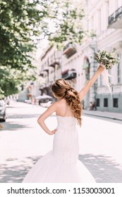 running bride with bouquet in hand