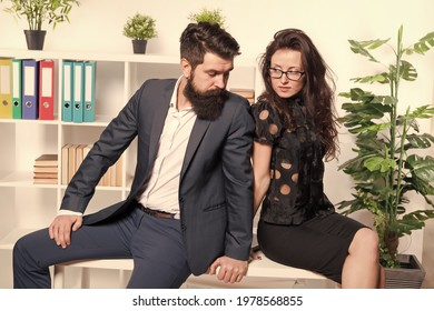 Running business together. Business couple sit on office desk. Sexy woman and bearded man in formalwear. Business relationship. Private business and entrepreneurship. Your success is our goal