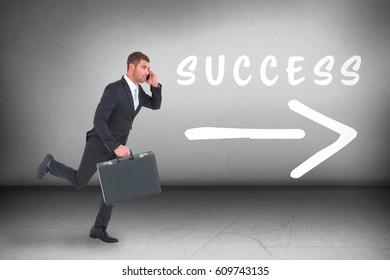 Running businessman against grey room
