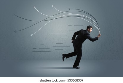 Running businessman with device and hand drawn lines concept on background