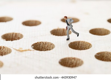 Running businessman and traps