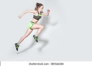 running caucasian woman studio isolated on white