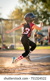 Running child playing baseball or softball