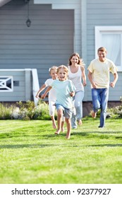 Running children and parents outdoors