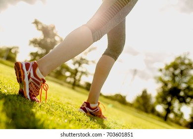 Running concept with young sportswoman