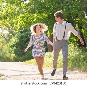 running couple  near blossom lilac tree