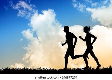 Running couple at sunset