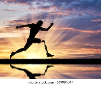 Running a disabled person with a prosthetic leg, confidently running on the ground and its reflection in the river
