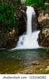 Running Eagle Falls in Glacier Nation Park.  Running Eagle Falls is named after a female warrior of the Amskapi-Pikuni Native American people.  This is a double water fall with both falls flowing in t
