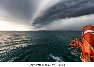 Running from fast coming storm with boat, approaching storm on lake