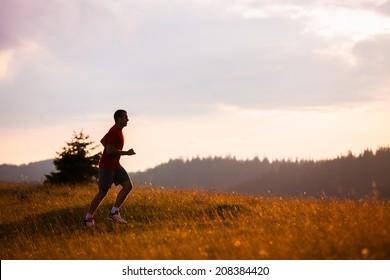 Running fitness man sprinting outdoors