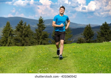 Running fitness man sprinting outdoors in beautiful landscape. Fit male runner training for marathon. Caucasian sport model.