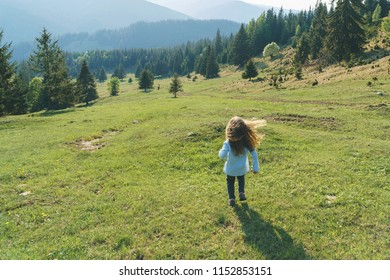 running girl with hair flying in wind