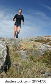 Running girl in shorts outdoor
