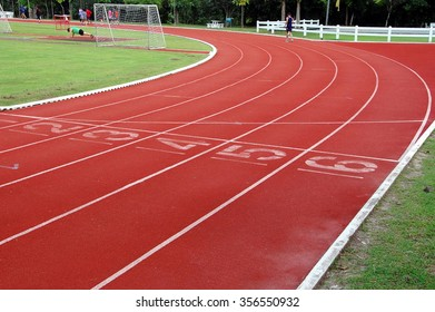 Running for health,running track and sports-field in green natural surrounding.