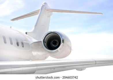 Running Jet Engine on a modern private jet airplane with a tail wing