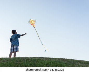 Running with kite silhouette