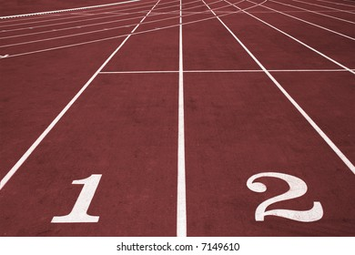 Running lanes with numbers on the stadium.