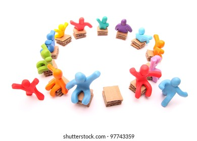 running for the last free spot - colorful group of plasticine people playing musical chairs - isolated on white