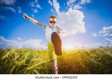 Running little happy kid  meadow weat field