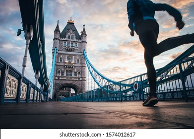 running in London Concept photo. Man running on Tower bridge. London Marathon photo