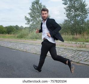 Running man is looking over his shoulder