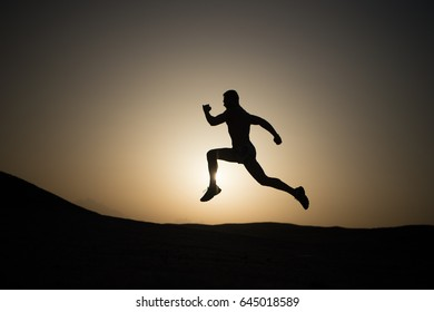 running man on mountain nature landscape on sky background in summer or spring, business and success, energy fitness, gym and health, sport and recreation
