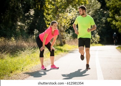 Running man passes next to resting woman runner and turns his head to her
