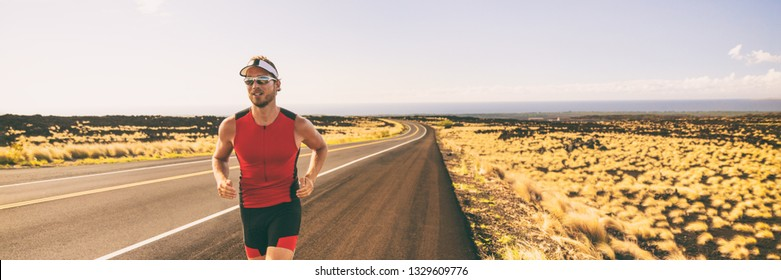 Running man training for triathlon sport run race in Hawaii. Banner panorama landscape sunset nature, triathlete runner jogging.