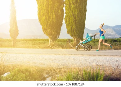 Running mother with child in stroller enjoying motherhood at sunset and mountains landscape. Jogging or power walking woman with pram on at sunset. Beautiful inspirational mountains landscape.