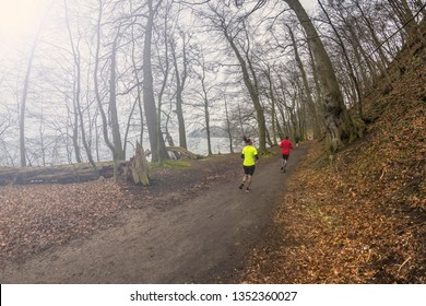 Running next to a lake in early spring
