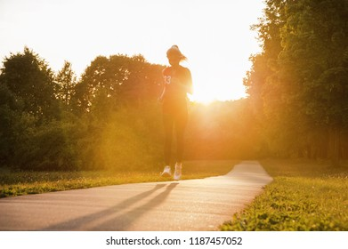 Running on the road at sunset