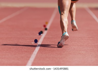 Running on track athlete to compete in long jump, starting acceleration in long jump competition