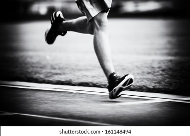 Running on the track black and white